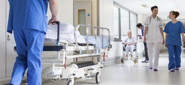 Doctors Hospital Corridor Nurse Pushing Gurney Stretcher Bed
